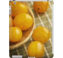 Yellow plum tomatoes on a wooden spoon iPad Case/Skin
