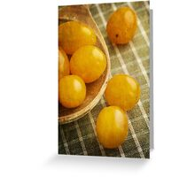 Yellow plum tomatoes on a wooden spoon Greeting Card
