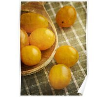 Yellow plum tomatoes on a wooden spoon Poster