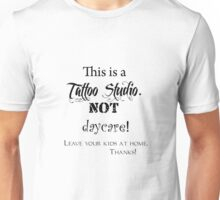 This is a Tattoo Studio.  NOT daycare! (for light colors & stickers) Unisex T-Shirt