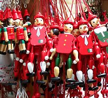 Colourful Red Toy Puppets in Prague Market Square by HotHibiscus