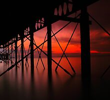 Peering Out From Under A Pier by jakeof