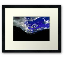 Dramatic blue skies with mountain silhouette taken in New Zealand Framed Print