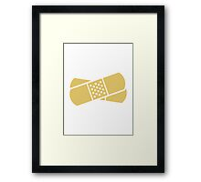 Crossed band-aids Framed Print