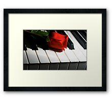 Keyboard romance Framed Print