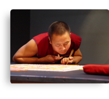 Tibetan monk creating sand mandala Canvas Print
