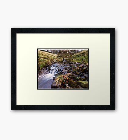 Footbridge and stream near Downham Framed Print