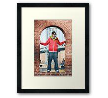 Boy with Manhatten Bridge in Background Framed Print