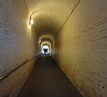 People starting to walk down a tunnel in Dover Castle by ashishagarwal74