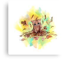 Kitty cat playing in a pile of leaves. Autumn Canvas Print