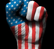 Flag of USA on a Raised Clenched Fist  by Jeff Bartels