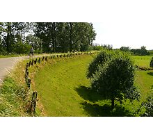 Cycling on a summer dike Photographic Print