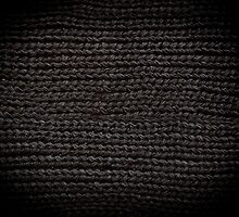 Black knitted fabric texture  by Arletta Cwalina