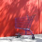Purple Trolley Red Wall by Christopher Dunn