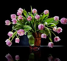 Pink tulips bouquet in glass vase by Arletta Cwalina