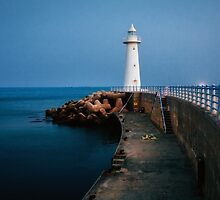 White lighthouse at dusk by Hotaik  Sung