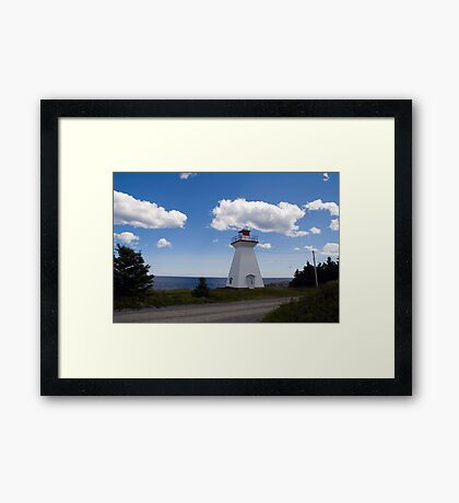 Lighthouse by the sea Framed Print