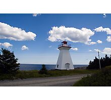 Lighthouse by the sea Photographic Print