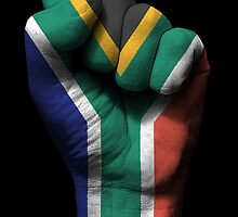 Flag of South Africa on a Raised Clenched Fist  by Jeff Bartels