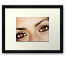 a fire in her eyes Framed Print