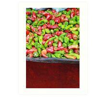 Seasoning peppers in a wheelbarrow in a market Art Print