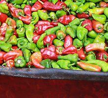Seasoning peppers in a wheelbarrow in a market by gustinegirl