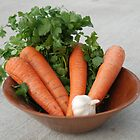 Carrots and Greens in Wooden Bowl by LenaHunt