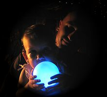 Father and daughter with light globe. by Marilyn Baldey