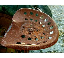 Rusty tractor seat Photographic Print