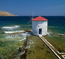 Floating windmill in the sea by Kostas Pavlis