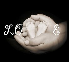 Baby's feet in father's hands. by jwestrope7