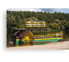 Sternwheeler moored on river  Canvas Print