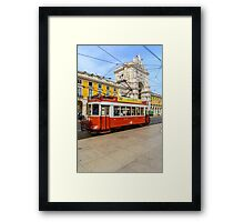 Old red tram at  triumphal arch on the Palace Square in Lisbon Framed Print