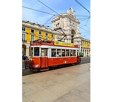 Old red tram at  triumphal arch on the Palace Square in Lisbon Photographic Print