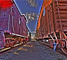 Between The Tracks by Scott  Remmers