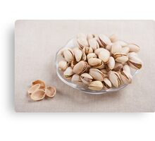 pistachio nuts in shell lying Canvas Print