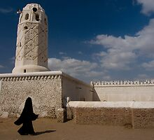 Yemeni woman passing a mosque - Yemen by Lisa Germany