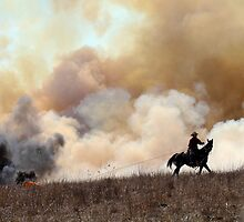 Kansas Rancher Starting a Controlled Burn by Catherine Sherman