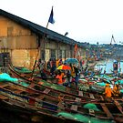 Boats and Umbrellas - Cape Coast, Ghana by Wayne King