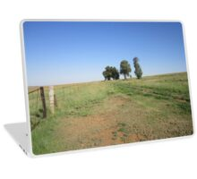 Trees and fence Laptop Skin
