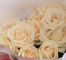 Creamy Apricot Roses in a bunch. by Marilyn Baldey