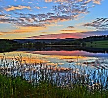 Lake with romantic sunset by artshop77