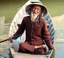 Boat man in Vietnam by tracyleephoto