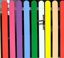 Multicolored rainbow picket fence by Arletta Cwalina