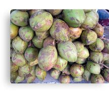 A number of tender raw coconuts in a pile Canvas Print
