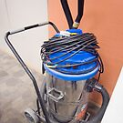 A powerful vaccum cleaner in a corner in office by ashishagarwal74