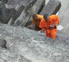 Monks Climbing Angkor Wat, Cambodia by Remine