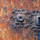 Old door with 3 keyholes by Arie Koene
