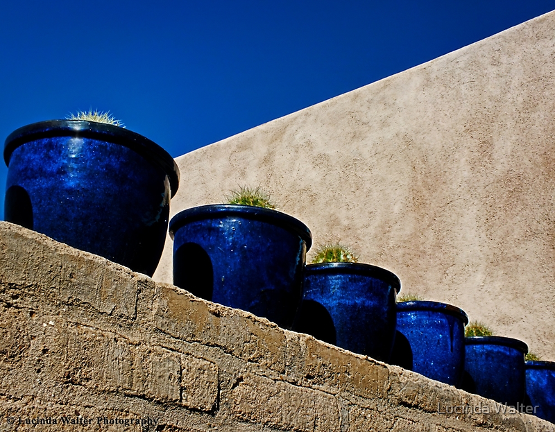 Blue Pottery on Wall by Lucinda Walter