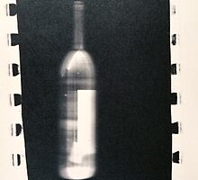 winebottle with film sprockets by adrienne bolsega